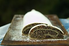 Poppy seed cake. Sprinkled with powdered sugar on a serving tray Royalty Free Stock Image