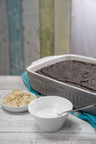 Poppy seed cake in baking dish, sugar frosting and almonds Stock Image
