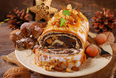 Poppy seed cake for christmas on wooden table Stock Photo