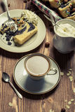 Poppy seed cake and cup of coffee Stock Images