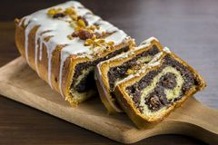 Poppy seed cake with nuts and raisins Royalty Free Stock Photo