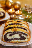 Poppy seed cake in golden christmas setting Stock Photo