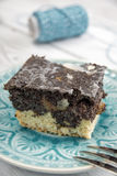 Poppy seed cake on plate Stock Photo
