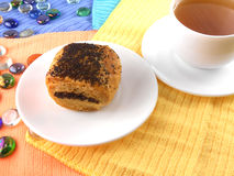 Poppy seed cake on plate and cup of tea (coffee) Royalty Free Stock Images