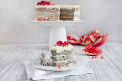 Poppy seed cake. Decorated with fresh berries and pomegranate on a light background Royalty Free Stock Photography