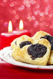 Poppy seed cookies in heart shape on the table Royalty Free Stock Image