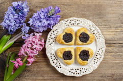 Poppy seed cookies in heart shape on wooden table Royalty Free Stock Photography