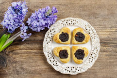 Poppy seed cookies in heart shape on wooden table Royalty Free Stock Photos