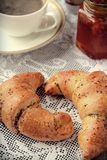 Poppy seed croissant with a cup of coffee Stock Photo