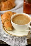 Poppy seed croissant with a cup of coffee Stock Image