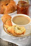 Poppy seed croissant with a cup of coffee Stock Photos
