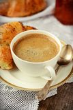 Poppy seed croissant with a cup of coffee Royalty Free Stock Photography