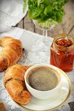 Poppy seed croissant with a cup of coffee Stock Photography