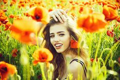 Poppy seed and happy girl with long curly hair royalty free stock images