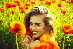 Poppy seed and happy girl with long curly hair stock photos