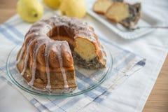 Poppy seed lemon sponge cake. Home made poppy seed lemon sponge cake Royalty Free Stock Photos
