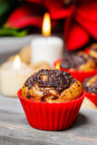 Poppy-seed muffins in christmas table setting Royalty Free Stock Image