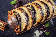 Poppy seed Roll on a dark background. Top view. Close-up Stock Images