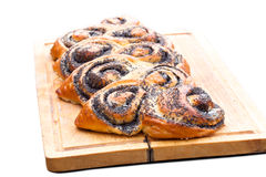 Poppy seed roll freshly baked on the table Stock Photo