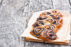 Poppy seed roll freshly baked on the table Stock Image