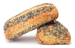 Poppy seed roll with sesame. Isolated on white background stock photo