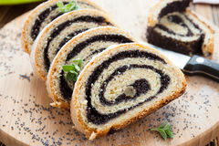 Poppy seed Roll on a wooden surface Royalty Free Stock Photo