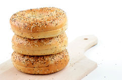 Poppy seed and sesame seed bagels. On wooden cutting board Stock Photos