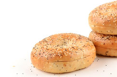 Poppy seed and sesame seed bagels. On white background with room for text Stock Photos