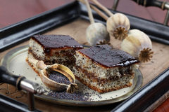 Poppy seed sponge cake with plum jam Stock Photos