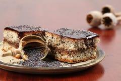 Poppy seed sponge cake with plum jam Stock Photo