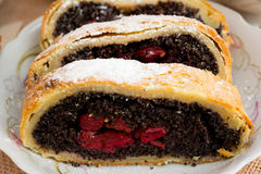 Poppy seed strudel with cherry royalty free stock photography