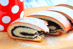 Poppy seed strudel and red cup with white polka dots Stock Photos