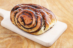 Poppy seed swedish bun. Traditional dessert Royalty Free Stock Images