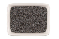 Poppy seeds in bowl isolated Royalty Free Stock Images