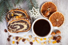 Poppy seeds cake, cup of coffee and spruce branches, dessert for Christmas Royalty Free Stock Images