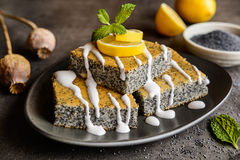 Poppy seeds cake with lemon topping. Delicious poppy seeds cake topped with lemon glaze royalty free stock images