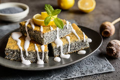 Poppy seeds cake with lemon topping. Delicious poppy seeds cake topped with lemon glaze stock image