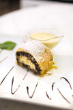Poppy seeds and cream cheese strudel with custard and mint Royalty Free Stock Image