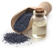 Poppy seeds with extract. In a small jar Royalty Free Stock Images