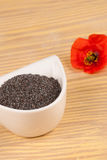 Poppy condiment on table Royalty Free Stock Image