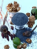 Poppy seeds and nuts. Still life of Poppy seeds and nuts Stock Photos