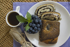 Poppy seeds strudel with cup of coffee and blueberry Royalty Free Stock Photo