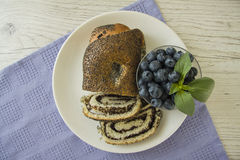 Poppy seeds strudel with cup of coffee and blueberry Stock Photo