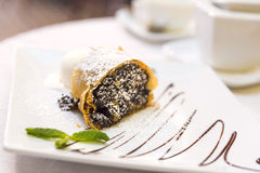 Poppy seeds and walnuts strudel with vanilla ice cream and mint Stock Photo