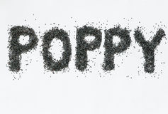 Poppy seeds on white background Royalty Free Stock Image