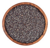 Poppy seeds in a wooden bowl on a white Royalty Free Stock Photography