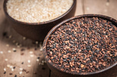 Poppy and sesame in wood bowl Royalty Free Stock Photos