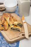 Poppy strudel. A german strudel of leavened dough with a poppy filling royalty free stock photos