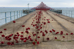 Poppy Wave at Southend-on-Sea. SOUTHEND-ON-SEA, UK - APRIL 16TH 2017:  The Poppy Wave installation by Paul Cummins and Tom Piper on Barge Pier in Shoeburyness Royalty Free Stock Photography