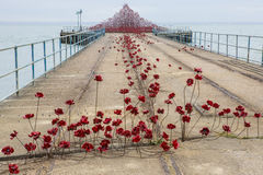Poppy Wave at Southend-On-Sea. SOUTHEND-ON-SEA, UK - APRIL 16TH 2017:  The Poppy Wave installation by Paul Cummins and Tom Piper on Barge Pier in Shoeburyness Royalty Free Stock Photos